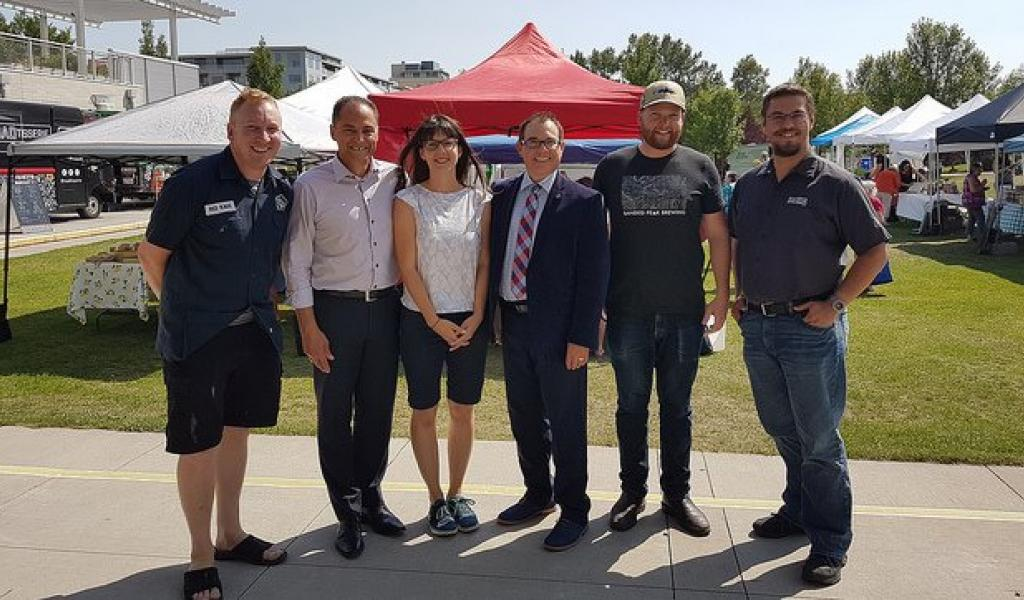 The Honourable Joe Ceci & Alain Maisonneuve (AGLC) celebrate new opportunities for Alberta's small liquor manufacturers at approved Alberta farmers' markets.